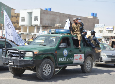 Taliban fighters in Kandahar city at the end of August