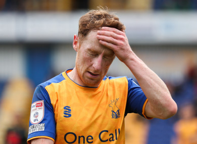 Mansfield Town's Stephen Quinn reacts after being sent off during a 3-1 defeat to Harrogate Town.