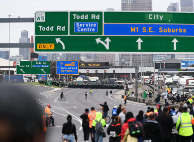 Police form a blockade on a freeway during the anti-vaccine protest