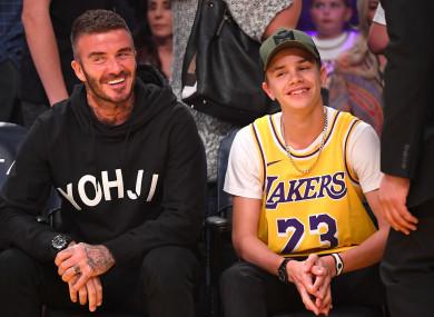 David Beckham (L) and Romeo Beckham at an LA Lakers match.