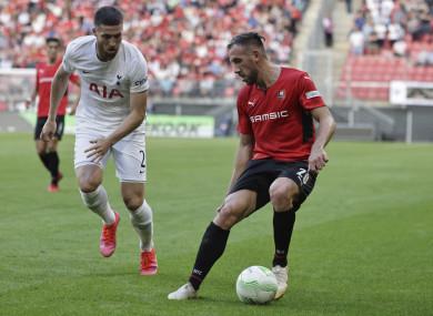 Rennes goalscorer Flavien Tait, right, challenges Matt Doherty for possession.