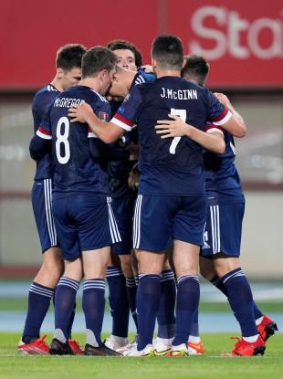 Scotland players celebrate after Lyndon Dykes goal.