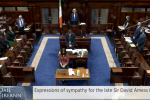 Politicians stand in the Dáil to observe a moment of silence for MP David Amess.
